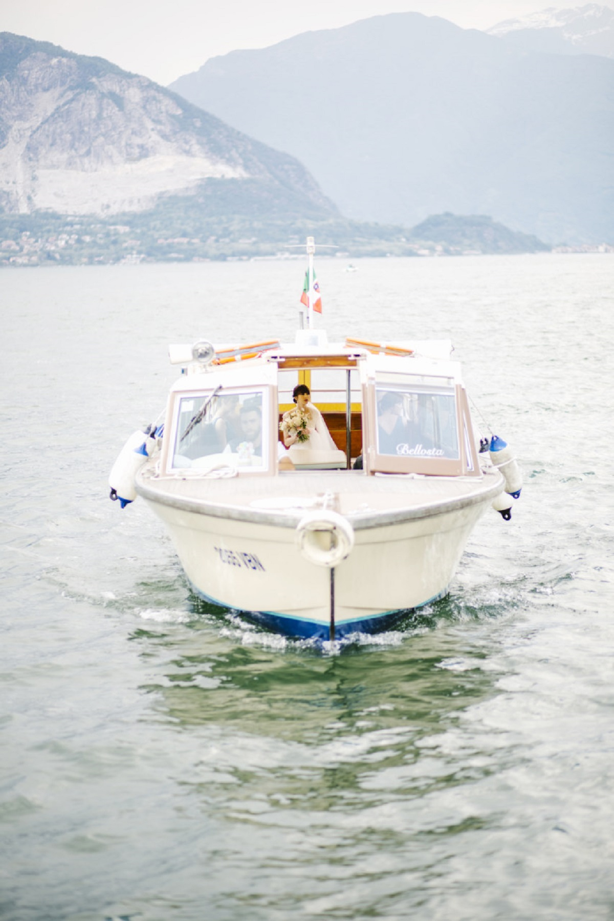 bride arrival get married in italy boat